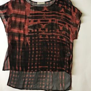 Sheer red and black top .